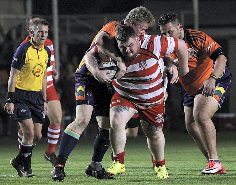 Sharjah, June, 01, 2018: RAK Rugby ( Red& White ) and  Arabian Knights ( Orange& BlacK) in action during the Nick Young Memorial match at the Sharjah Wanderers sports club in Sharjah . Satish Kumar for the National / Story by Paul Radley