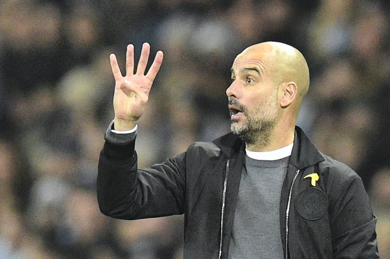 Manchester City's Spanish manager Pep Guardiola gestures on the touchline during the English Premier League football match between Manchester City and Bournemouth at the Etihad Stadium in Manchester, north west England, on December 23, 2017. (Photo by Oli SCARFF / AFP) / RESTRICTED TO EDITORIAL USE. No use with unauthorized audio, video, data, fixture lists, club/league logos or 'live' services. Online in-match use limited to 75 images, no video emulation. No use in betting, games or single club/league/player publications. /