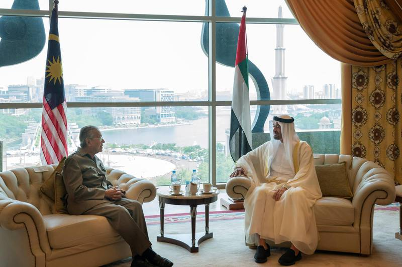 KUALA LUMPUR, MALAYSIA - July 30, 2019: HH Sheikh Mohamed bin Zayed Al Nahyan, Crown Prince of Abu Dhabi and Deputy Supreme Commander of the UAE Armed Forces (R) meets with HE Mahathir Bin Mohamad, Prime Minister of Malaysia (L), at the Prime Minister's office.  ( Mohammed Al Hammadi / Ministry of Presidential Affairs ) ---