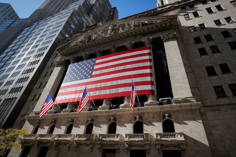 The U.S. flag covers the front facade of the New York Stock Exchange (NYSE) in New York City, New York, U.S., November 9, 2020. REUTERS/Brendan McDermid