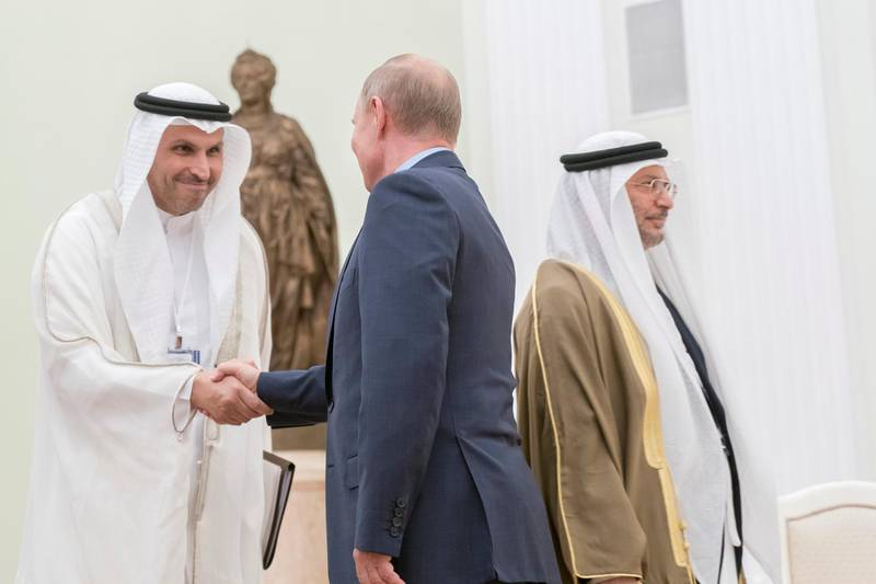 MOSCOW, RUSSIA - June 01, 2018: HE Vladimir Putin Vladimirovich, President of Russia (2nd L) greets HH Sheikh Tahnoon bin Zayed Al Nahyan, UAE National Security Advisor (L), at the Kremlin Palace. Seen with HE Dr Anwar bin Mohamed Gargash, UAE Minister of State for Foreign Affairs (R).  ( Rashed Al Mansoori / Crown Prince Court - Abu Dhabi ) ---