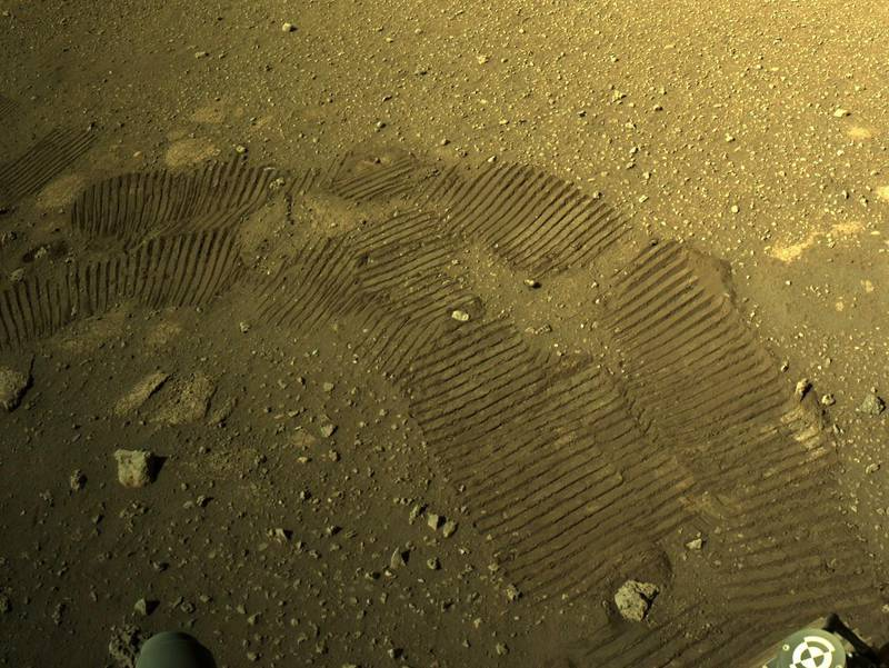 epa09054568 A handout photo made available by NASA shows tyre marks left by NASA's Perseverance Mars rover, 05 March 2021. The rover moved for the first time since landing on Mars on February, 18. Perseverance's main mission on Mars is astrobiology and the search for signs of ancient microbial life, according to NASA.  EPA/NASA/JPL-Caltech HANDOUT  HANDOUT EDITORIAL USE ONLY/NO SALES HANDOUT EDITORIAL USE ONLY/NO SALES