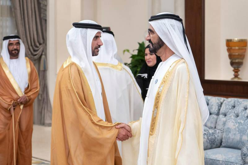 ABU DHABI, UNITED ARAB EMIRATES - August 21, 2018: HH Sheikh Mohamed bin Rashid Al Maktoum, Vice-President, Prime Minister of the UAE, Ruler of Dubai and Minister of Defence (R), greets HH Sheikh Ahmed bin Saif bin Mohamed Al Nahyan (2nd R), during an Eid Al Adha reception at Mushrif Palace.    (Rashed Al Mansoori / Crown Prince Court - Abu Dhabi ) ---