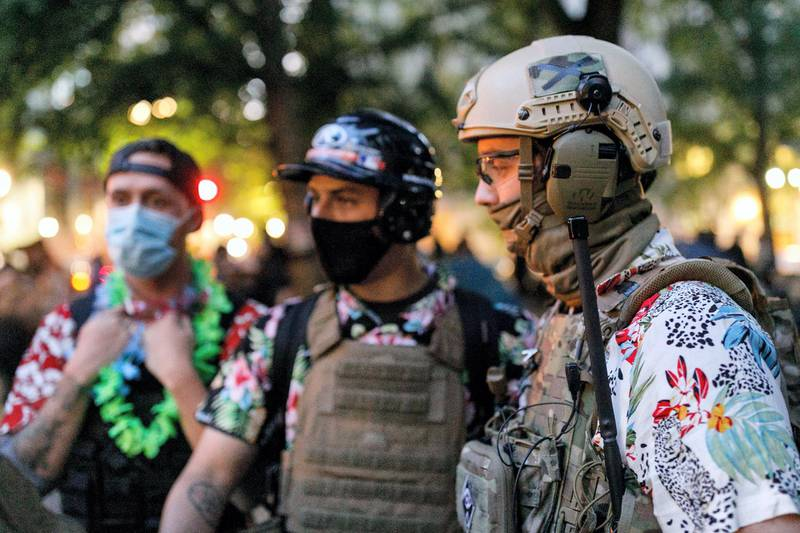 PORTLAND, OREGON, USA - JULY 24: The 'Boogaloo Bois', an armed libertarian group, dress in their signature Hawaiian shirts during a protest on 24, 2020 in Portland, United States. Thousands of people, including mothers, lawyers, health-care workers, and veterans demonstrated in Portland, Oregon on July 24, 2020 for racial justice, and against Donald Trumpâs insertion of Federal officers into Portland, Oregon. (Photo by John Rudoff/Anadolu Agency via Getty Images)
