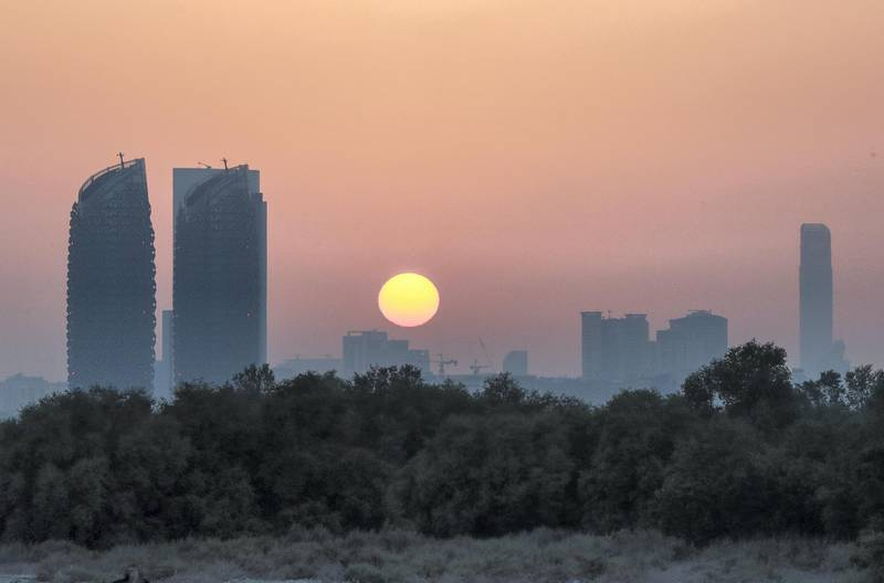 Abu Dhabi, U.A.E., June 24, 2018.  Al Reem Island sunset shot from the Eastern Mangroves area on June 21, 2018.Victor Besa / The NationalReporter: Section:  Stock Images