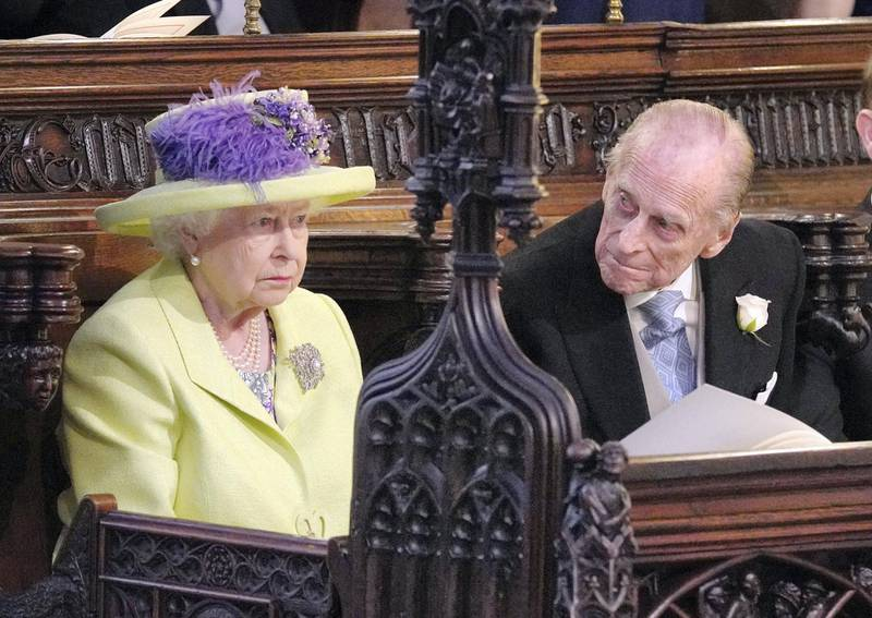 Britain's Queen Elizabeth II and Britain's Prince Philip, Duke of Edinburgh (R) during the wedding ceremony of Britain's Prince Harry, Duke of Sussex and US actress Meghan Markle in St George's Chapel, Windsor Castle, in Windsor, on May 19, 2018. (Photo by Jonathan Brady / POOL / AFP)