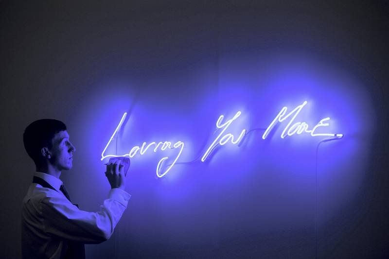 LONDON, ENGLAND - OCTOBER 12:  A Sotheby's art handler poses for photographs next to Loving You More by Tracey Emin, estimated at £25,000-£35,000, during an Art for Grenfell press call at Sotheby's Art for Grenfell preview on October 12, 2017 in London, United Kingdom. The 'Art for Grenfell' auction will take place on October 16 2017 and includes work by contemporary artists.  (Photo by Chris J Ratcliffe/Getty Images for Sotheby's)