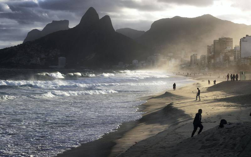 RIO DE JANEIRO, BRAZIL - JUNE 02: People walk at the edge of the Atlantic Ocean on Ipanema beach on June 2, 2017 in Rio de Janeiro, Brazil. According to the Urban Climate Change Research Network (UCCRN), Rio's average temperature would rise around one degree Celsius between 2015 and 2020 along with a sea level rise of 14 cm. Changes in Rio's climate are projected to be the most dire of all cities in South America, according to UCCRN. U.S. President Donald Trump announced June 1 that he will withdraw the United States from the Paris Agreement on climate change. BrazilÕs Ministry of Foreign Affairs and Ministry of Environment stated ÔBrazil is seriously concerned with the negative impact of such decision on the multilateral dialogue and cooperation to respond to global changes.Õ  (Photo by Mario Tama/Getty Images)