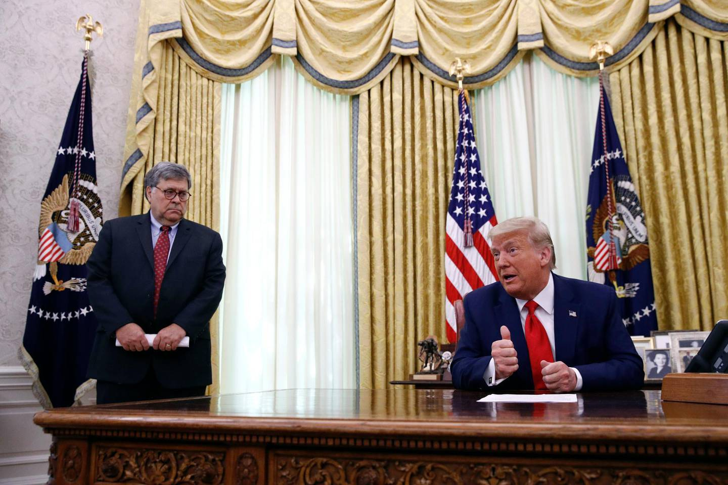FILE - In this June 15, 2020, file photo President Donald Trump speaks alongside Attorney General William Barr during a law enforcement briefing on the MS-13 gang in the Oval Office of the White House in Washington. Barr is scheduled to appear for the first time before the House Judiciary Committeeon Tuesday, July 28.  (AP Photo/Patrick Semansky, File)