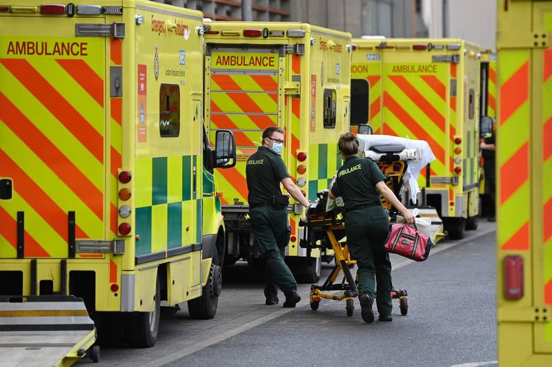 London Ambulance staff stretcher a patient from the ambulance into The Royal London Hospital in east London, on January 2, 2021. Health Services are under increasing pressure after record levels of daily lab-confirmed cases of Covid-19 has led to more patients being treated in hospital in England than during the initial peak of the outbreak in April. / AFP / DANIEL LEAL-OLIVAS