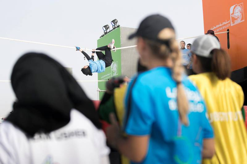 DUBAI, UNITED ARAB EMIRATES - MAY 9, 2018. Rope climbing challenge at the first day of Dubai Government Games begins, with female government employees taking part in multiple physical challenges.Set in motion by the Crown Prince of Dubai,  Sheikh Hamdan bin Mohammed, the event sees teams of Government workers pitted against each other in a bid to be Gov Games champions.The competition is held on Kite Beach.(Photo by Reem Mohammed/The National)Reporter: Nawal Al RamahiSection: NA