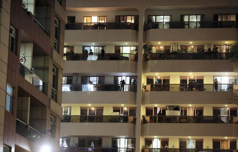 DUBAI, UNITED ARAB EMIRATES , March 25 – 2020 :- UAE residents cheering from their balconies and homes on Wednesday night at Al Mankhool area in Bur Dubai for doctors and medical staff for their tireless efforts in these critical times in Dubai. (Pawan Singh / The National) For News/Online/Standalone/Instagram
