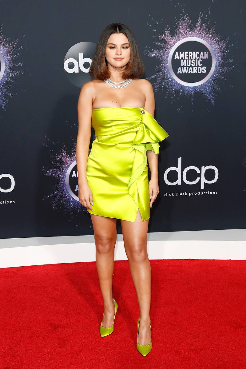 epa08023368 US singer Selena Gomez poses for photographers as she arrives at the 2019 American Music Awards at the Microsoft Theater in Los Angeles, California, USA, 24 November 2019.  EPA-EFE/NINA PROMMER