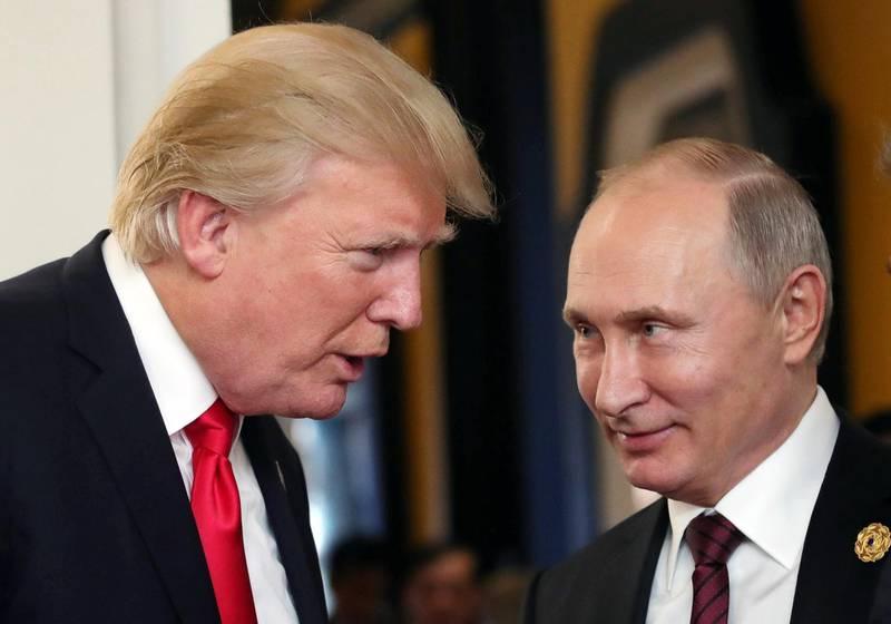 epa06885713 (FILE) - Russian President Vladimir Putin (R) and US President Donald J. Trump (L) talk during a break of a leader's meeting at the 25th Asia-Pacific Economic Cooperation (APEC) summit in Da Nang, Vietnam, 11 November 2017 (reissued 13 July 2018). US President Donald J. Trump and Russian President Putin will meet in Helsinki, Finland on 16 July 2018.  EPA/MIKHAIL KLIMENTYEV/SPUTNIK/KREML MANDATORY CREDIT *** Local Caption *** 53952090
