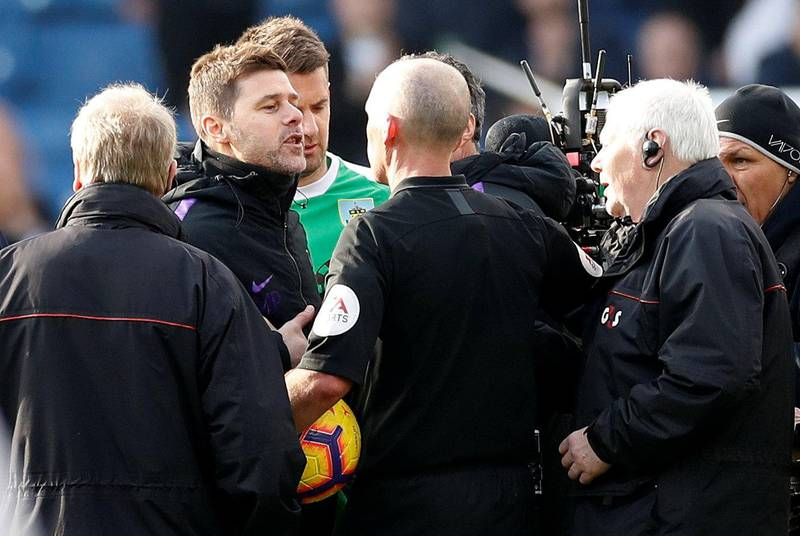 """Soccer Football - Premier League - Burnley v Tottenham Hotspur - Turf Moor, Burnley, Britain - February 23, 2019  Tottenham manager Mauricio Pochettino remonstrates with referee Mike Dean after the match          Action Images via Reuters/Carl Recine  EDITORIAL USE ONLY. No use with unauthorized audio, video, data, fixture lists, club/league logos or """"live"""" services. Online in-match use limited to 75 images, no video emulation. No use in betting, games or single club/league/player publications.  Please contact your account representative for further details."""