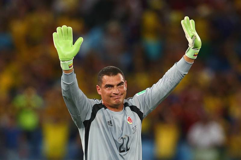 CUIABA, BRAZIL - JUNE 24:  Goalkeeper Faryd Mondragon of Colombia acknowledges the fans after the 2014 FIFA World Cup Brazil Group C match between Japan and Colombia at Arena Pantanal on June 24, 2014 in Cuiaba, Brazil.  (Photo by Mark Kolbe/Getty Images)