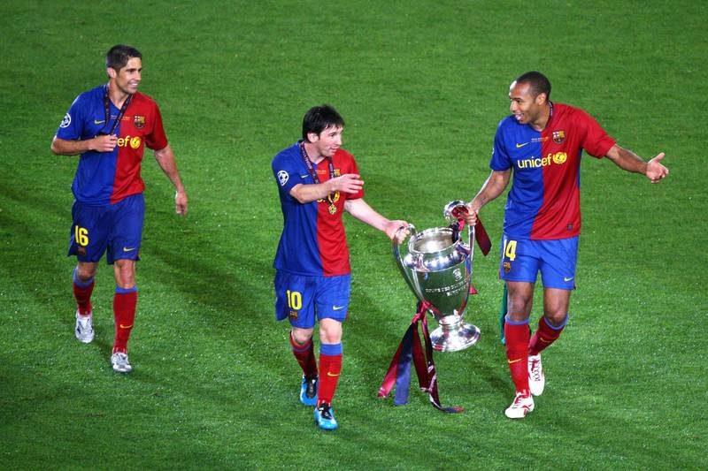 ROME - MAY 27:  Thierry Henry of Barcelona and Lionel Messi of Barcelona celebrate winning the UEFA Champions League Final match between Manchester United and Barcelona at the Stadio Olimpico on May 27, 2009 in Rome, Italy. Barcelona won 2-0.  (Photo by Paul Gilham/Getty Images)