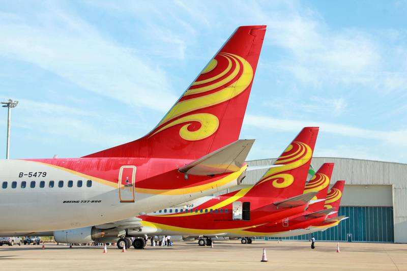 --FILE--Jet planes of Hainan Airlines of HNA Group are pictured at the Haikou Meilan International Airport in Haikou city, south China's Hainan province, 19 September 2015.  China's HNA Group and a firm backed by tycoon Li Ka-shing are among suitors advancing to a second round of bidding for CIT Group's aircraft leasing assets valued from US$3 billion to US$4 billion, people familiar with the situation said. CIT's commercial air unit is one of the world's top-10 lessors with 331 aircraft — an attractive target particularly for Chinese firms whose enthusiasm for the US$228 billion global aircraft leasing market has climbed in tandem with rapid growth in Chinese air travel. The people said HNA is the leading contender for the US lender's assets. Bohai Capital, HNA's leasing arm, has said it is planning to add 300 to 400 planes to the 500-plus it has on order and in service. Others going to the next round include Ping An Insurance, which has an aircraft leasing arm, and Century Tokyo Leasing, which has joint ventures with CIT, the people said.