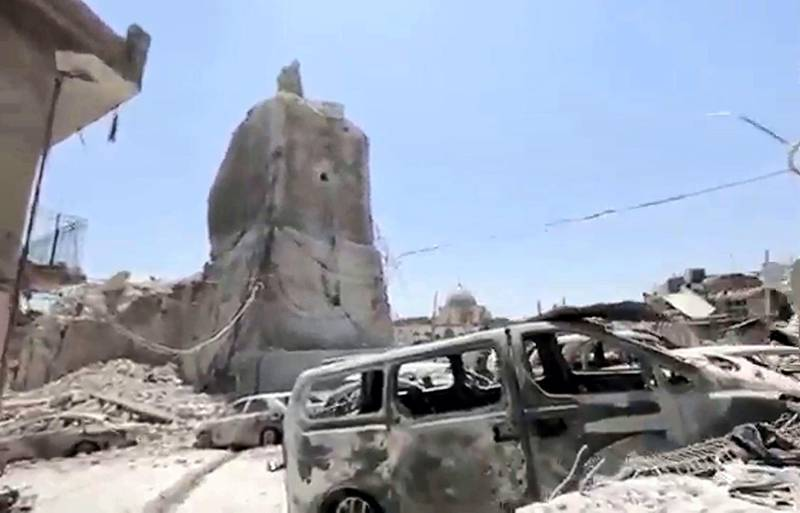 """An image grab taken from a video relesead online by the Islamic state group's Amaq propaganda agency on June 23, 2017 shows Mosul's trademark leaning minaret  destroyed after jihadists blew it up, according to officials from Iraq and the US-led anti-IS coalition, as Iraqi forces advanced on an ancient mosque compound in the embattled northern city. - Mosul's trademark leaning minaret was missing from its skyline for the first time in centuries after desperate jihadists blew it up as Iraqi forces advanced on an ancient mosque compound in the embattled northern city. Explosions on June 21 evening levelled both the Nuri mosque where Abu Bakr al-Baghdadi gave his first sermon as leader of the Islamic State group and its ancient leaning minaret, known as the """"Hadba"""" (Hunchback). (Photo by Handout / various sources / AFP) / RESTRICTED TO EDITORIAL USE - MANDATORY CREDIT """"AFP PHOTO / HO / AAMAQ NEWS AGENCY"""" - NO MARKETING NO ADVERTISING CAMPAIGNS - DISTRIBUTED AS A SERVICE TO CLIENTS FROM ALTERNATIVE SOURCES, AFP IS NOT RESPONSIBLE FOR ANY DIGITAL ALTERATIONS TO THE PICTURE'S EDITORIAL CONTENT, DATE AND LOCATION WHICH CANNOT BE INDEPENDENTLY VERIFIE /"""
