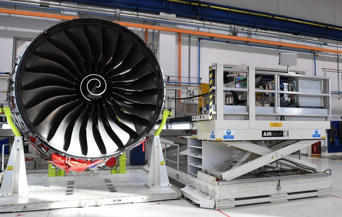 """(FILES) This file photograph taken on November 30, 2016, shows Rolls Royce Trent XWB engines on view on the assembly line at the Rolls Royce factory in Derby, central England. British aircraft engine maker Rolls-Royce said March 11, 2021, that its net losses more than doubled last year to £3.2 billion, hit by the fallout from the  coronavirus pandemic. The loss after tax, equivalent to $4.4 billion or 3.7 billion euros, compared with a loss of £1.3 billion in 2019, Rolls-Royce said. The Covid-19 pandemic had had a """"severe impact"""" on its performance, it added.  / AFP / POOL / Paul ELLIS"""