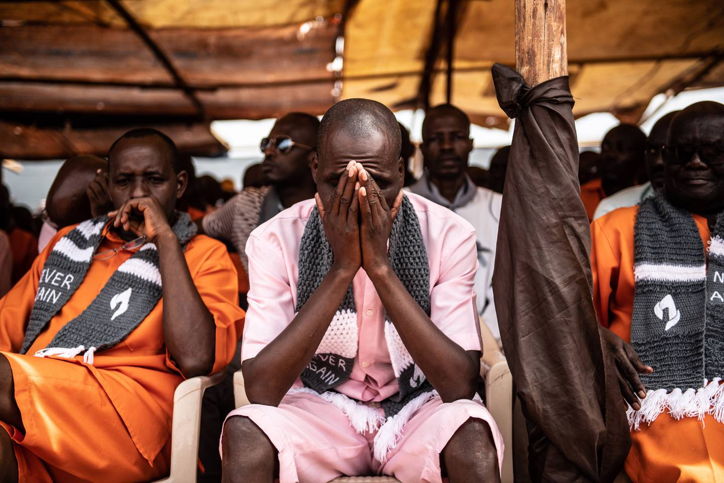 KIGALI, RWANDA - APRIL 07: Prisoners listen during a Genocide commemoration ceremony on April 07, 2019 at Nyarugenge Prison in Kigali, Rwanda. The prison holds many perpetrators of the genocide still serving their sentences after being found guilty. The country is preparing to commemorate the 25th anniversary of the genocide in which 800,000 Tutsis and moderate Hutus were killed over a 100-day period.  (Photo by Andrew Renneisen/Getty Images)