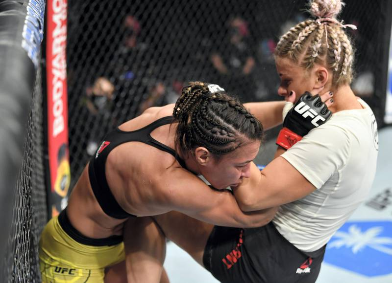 ABU DHABI, UNITED ARAB EMIRATES - JULY 12: (R-L) Paige VanZant knees Amanda Ribas of Brazil in their flyweight fight during the UFC 251 event at Flash Forum on UFC Fight Island on July 12, 2020 on Yas Island, Abu Dhabi, United Arab Emirates. (Photo by Jeff Bottari/Zuffa LLC)