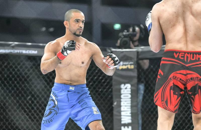Abu Dhabi, United Arab Emirates - Emirati fighter Ahmed Al Darmaki vs. Azouz Anwar from Egypt at the UAE Warriors MMA event at the Mubadala Arena, Zayed Sports City. Khushnum Bhandari for The National