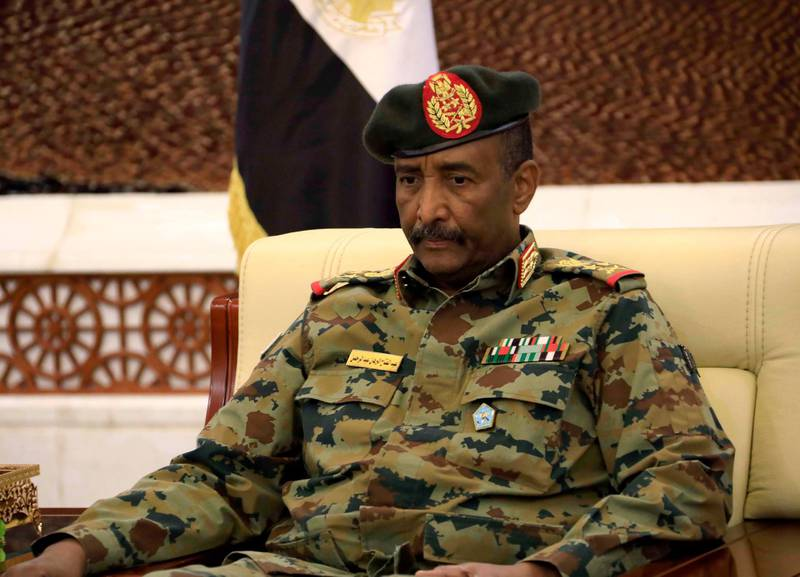 epa07783657 Leader of Sudan's transitional council, Lieutenant General Abdel Fattah Abdelrahman Burhan looks on after  being sworn in as the Head of the newly formed transitional Council at the presidential palace in Khartoum, Sudan, 21 August 2019. The Sudanese opposition and military council signed on 17 August a power sharing agreement. The agreement sets up a sovereign council made of five generals and six civilians, to rule the country until general elections. Protests had erupted in Sudan at the end of 2018, culminating in a long sit-in outside the army headquarters which ended with more than one hundred people being killed and others injured. Sudanese President Omar Hassan al-Bashir stepped down on 11 April 2019  EPA/STRINGER