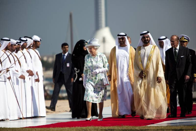 November 25, 2010 - Abu Dhabi, UAE -   Queen Elizabeth II arrives at Emirates Palace with Sheikh Mohammed Bin Zayed Al Nahyan, Crown Prince and Deputy Supreme Commander, middle, Sheikh Mohammed Bin Rashid Al Maktoum, the Prime Minister and Vice President of the United Arab Emirates, right, Sheikh Abdullah Bin Zayed Al Nahyan, Minister of Foreign Affairs, not pictured,  Prince Philip, the Duke of Edinburgh, not pictured, and Prince Andrew, the Duke of York, not pictured, for the unveiling of Zayed National Museum on Thursday November 25, 2010.    (Andrew Henderson/The National)