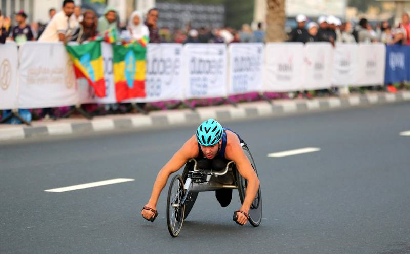 Dubai, United Arab Emirates - January 25, 2019: A competitor in the mens wheelchair race at the Standard Chartered Dubai Marathon 2019. Friday, January 25th, 2019 at Jumeirah, Dubai. Chris Whiteoak/The National