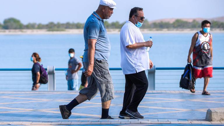 An image that illustrates this article Coronavirus latest: UAE eases face mask rules in some public places