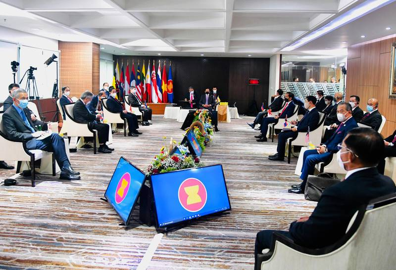 In this photo released by Indonesian Presidential Palace, Myanmar's Commander-in-Chief Senior General Min Aung Hlaing, bottom right, and ASEAN leaders convene during their meeting at the ASEAN Secretariat in Jakarta, Indonesia, Saturday, April 24, 2021. Southeast Asian leaders met Myanmar's top general and coup leader in an emergency summit in Indonesia Saturday, and are expected to press calls for an end to violence by security forces that has left hundreds of protesters dead as well as the release of Aung San Suu Kyi and other political detainees. (Laily Rachev, Indonesian Presidential Palace via AP)