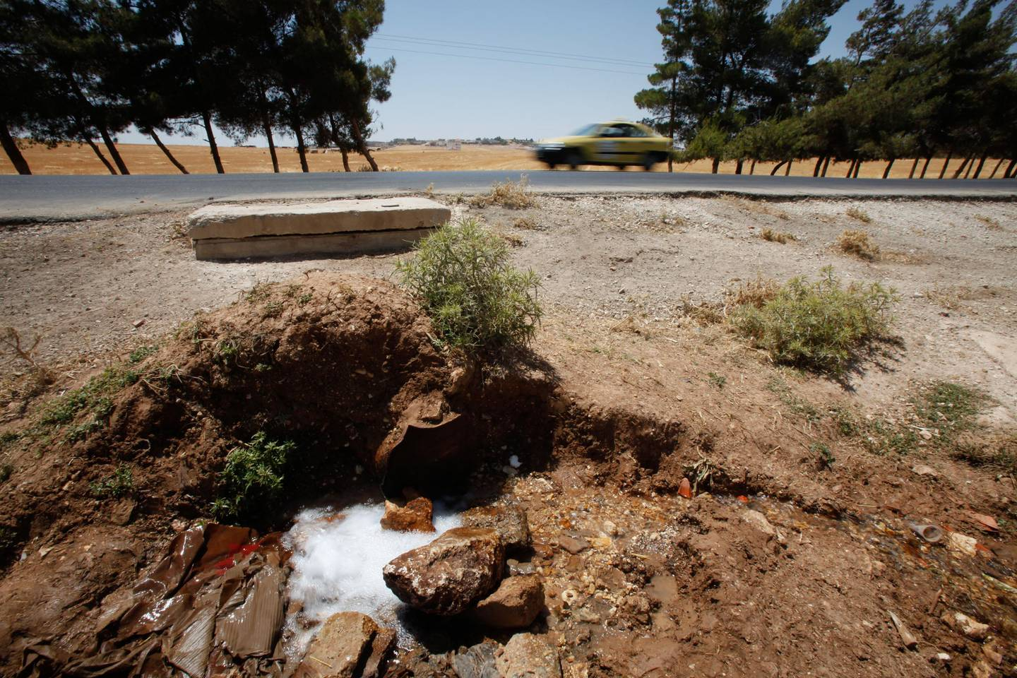 Water flow from a central pipe near the city of Madaba, south of Amman in an aggression by farmers to irrigate their farms in Madaba, Jordan on June 18, 2010. (Salah Malkawi for The National)