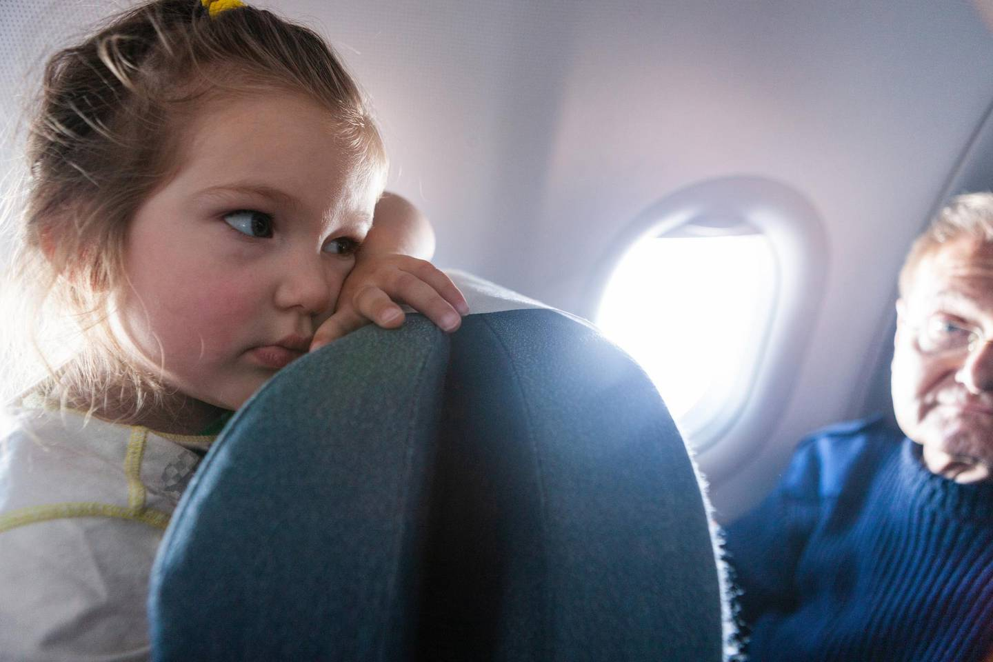 A bored child in the plane. Getty Images