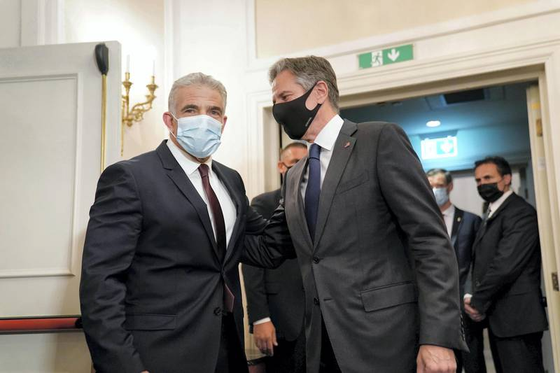 Secretary of State Antony Blinken, right, greets Israeli Foreign Minister Yair Lapid during their meeting in Rome, Sunday, June 27, 2021. Blinken is on a week long trip in Europe traveling to Germany, France and Italy. (AP Photo/Andrew Harnik, Pool)