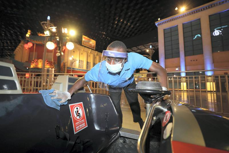Dubai, United Arab Emirates - Reporter: N/A. Covid-19/Coronavirus. Kelvin cleans the Flight of the Quinjets ride after people have been on it. IMG World of Adventure opened on recently to the public with strict Covid-19/Coronavirus safety measures. Tuesday, July 21st, 2020. Dubai. Chris Whiteoak / The National