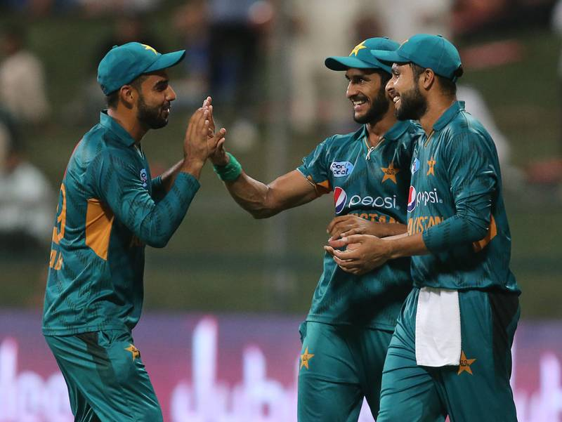 In this picture taken on October 24, 2018, Pakistan cricketer Hasan Ali celebrates with teammates after dismissing Australian cricketer Adam Zampa during the first Twenty20 cricket match between Australia and Pakistan at Sheikh Zayed Stadium in Abu Dhabi. / AFP / -