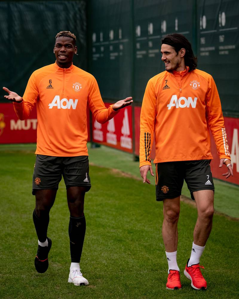 MANCHESTER, ENGLAND - MARCH 16: (EXCLUSIVE COVERAGE) Paul Pogba, Edinson Cavani of Manchester United in action during a first team training session at Aon Training Complex on March 16, 2021 in Manchester, England. (Photo by Ash Donelon/Manchester United via Getty Images)