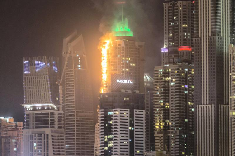 DUBAI. UNITED ARAB EMIRATES, 04 AUGUST 2017. A massive fire rips through The Marina Torch tower's southern corner. (Photo: Antonie Robertson) Journalist: None. Section: National.