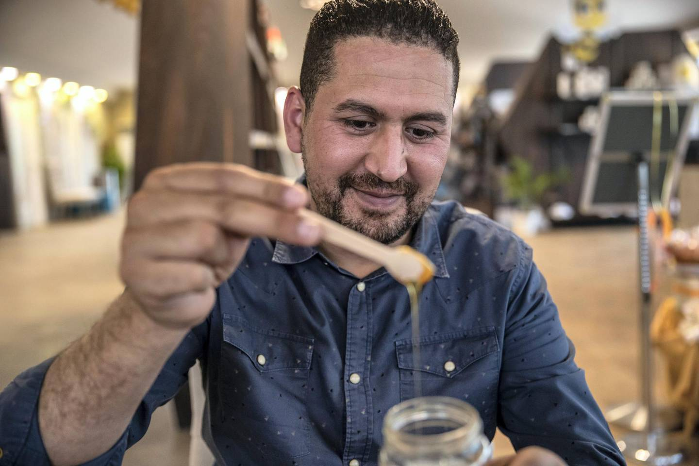DUBAI, UNITED ARAB EMIRATES. 06 OCTOBER 2020. JA Hatta Fort Hotel has launched a collaboration with the Hatta Honey Bee Discovery Centre to use theyr products in the Food and Beverage menu of the hotel. Mohamed Quertani, Garden Manager, explins some of the finer points of tasting honey. (Photo: Antonie Robertson/The National) Journalist: janice Rodriguez. Section: Arts & Life.