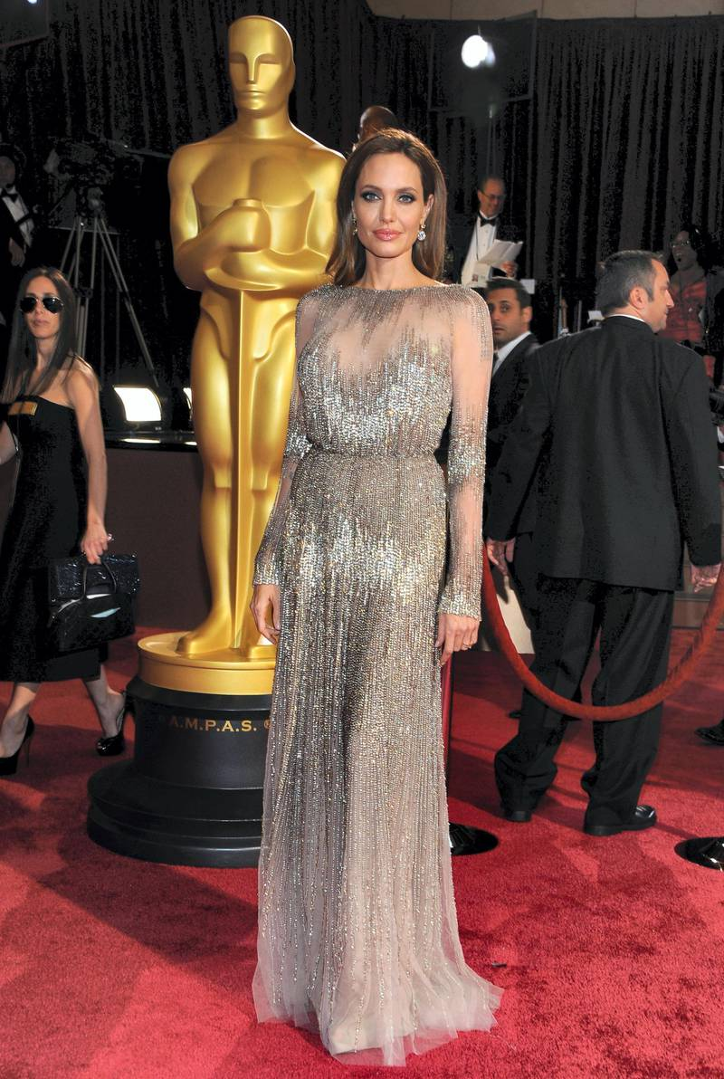 Actress Angelina Jolie arrives on the red carpet for the 86th Academy Awards on March 2nd, 2014 in Hollywood, California. AFP PHOTO / VALERIE MACON (Photo by VALERIE MACON / AFP)
