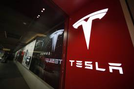 Tesla posts record profit on increased vehicle deliveries