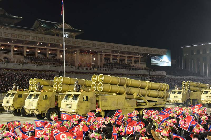 """This picture taken on January 14, 2021 and released from North Korea's official Korean Central News Agency (KCNA) on January 15 shows a military parade celebrating the 8th Congress of the Workers' Party of Korea (WPK) in Pyongyang. (Photo by - / KCNA VIA KNS / AFP) / - South Korea OUT / REPUBLIC OF KOREA OUT   ---EDITORS NOTE--- RESTRICTED TO EDITORIAL USE - MANDATORY CREDIT """"AFP PHOTO/KCNA VIA KNS"""" - NO MARKETING NO ADVERTISING CAMPAIGNS - DISTRIBUTED AS A SERVICE TO CLIENTS THIS PICTURE WAS MADE AVAILABLE BY A THIRD PARTY. AFP CAN NOT INDEPENDENTLY VERIFY THE AUTHENTICITY, LOCATION, DATE AND CONTENT OF THIS IMAGE. /"""