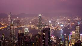Fitch downgrades Hong Kong as protests raise questions about its governance