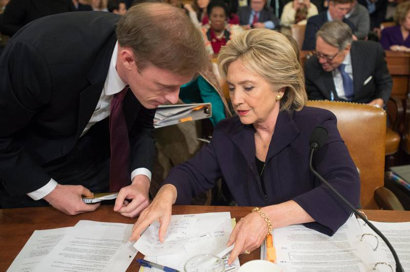 epa08837920 (FILE) - Former Secretary of State and Democratic presidential candidate Hillary Clinton (R) speaks with former Clinton staff member at the State Department, Jake Sullivan (L), during a break from testifying at the House Select Committee on Benghazi, on Capitol Hill in Washington DC, USA, 22 October 2015 (reissued 23 November 2020). President-elect Joe Biden selected Jake Sullivan as his National Security Advisor.  EPA/MICHAEL REYNOLDS