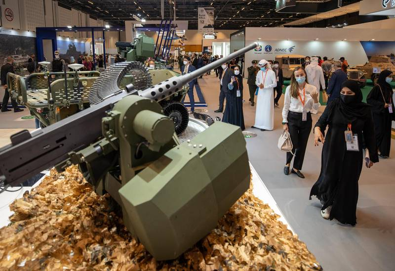 Abu Dhabi, United Arab Emirates, February 24, 2021.  Idex 2021 Day 4. Visitors at the RCWS Remote Controlled Weapons Station located at the KOREA exhibition area in ADNEC.Victor Besa / The NationalSection:  NA
