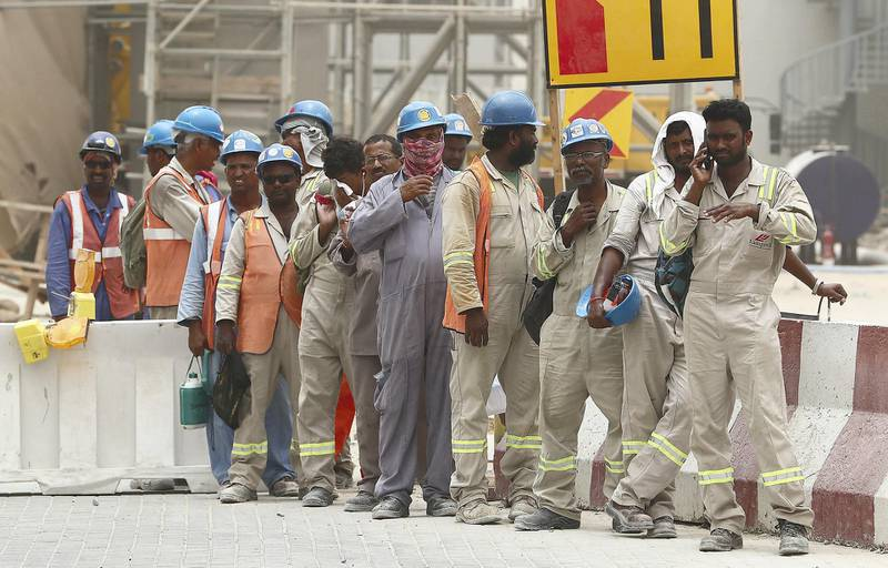 DUBAI , UNITED ARAB EMIRATES , JULY 30 – 2018 :- Labourers waiting for their staff bus during the dusty and hot weather in Discovery Gardens area in Dubai. ( Pawan Singh / The National )  For News.
