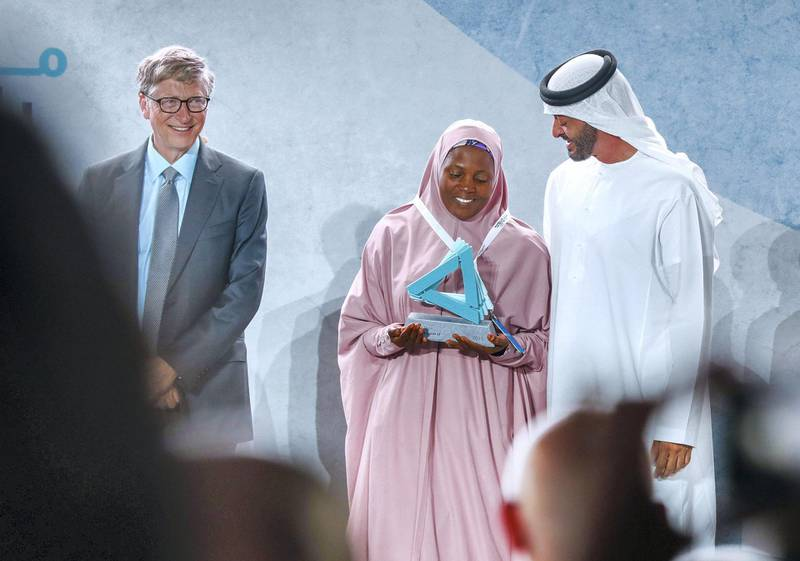 Abu Dhabi, United Arab Emirates, November 19 , 2019.  Reaching the Last Mile Forum.--Bill Gates and H.E. Sheikh Mohamed bin Zayed, Crown Prince of Abu Dhabi and Deputy Supreme Commander of the UAE Armed Forces with awards winner Rahane Lawal.Victor Besa / The NationalSection:  NAReporter:  Dan Sanderson