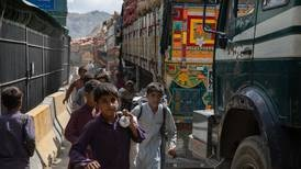 Afghan children cling to lorries to be smuggled into Pakistan