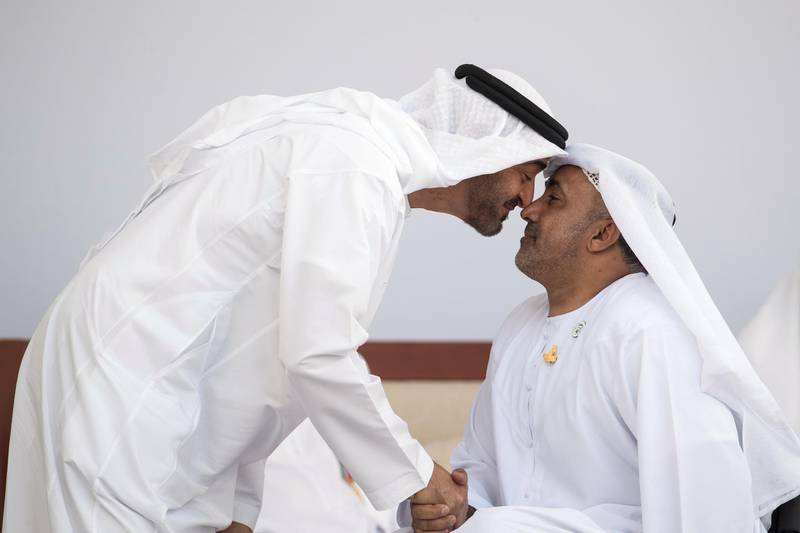 ABU DHABI, UNITED ARAB EMIRATES -  March 12, 2018: HH Sheikh Mohamed bin Zayed Al Nahyan, Crown Prince of Abu Dhabi and Deputy Supreme Commander of the UAE Armed Forces (L), greets Abu Dhabi Award winner, Theban Salem Al Mheiri (R), during the awards ceremony at the Sea Palace. ( Ryan Carter for the Crown Prince Court - Abu Dhabi ) ---